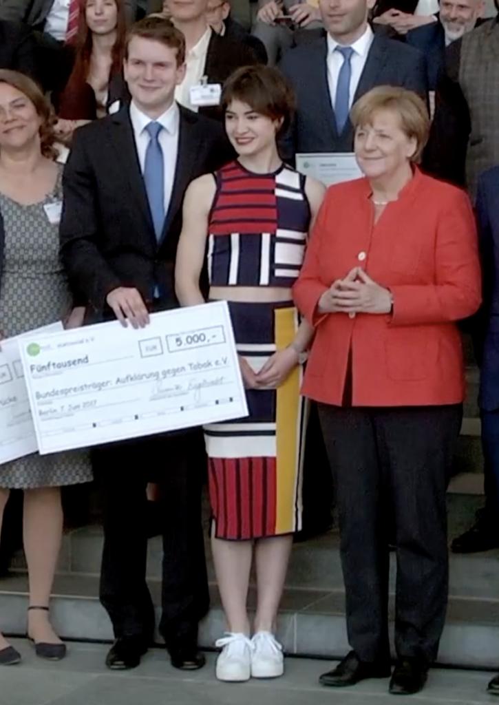 Titus Brinker, Angela Merkel